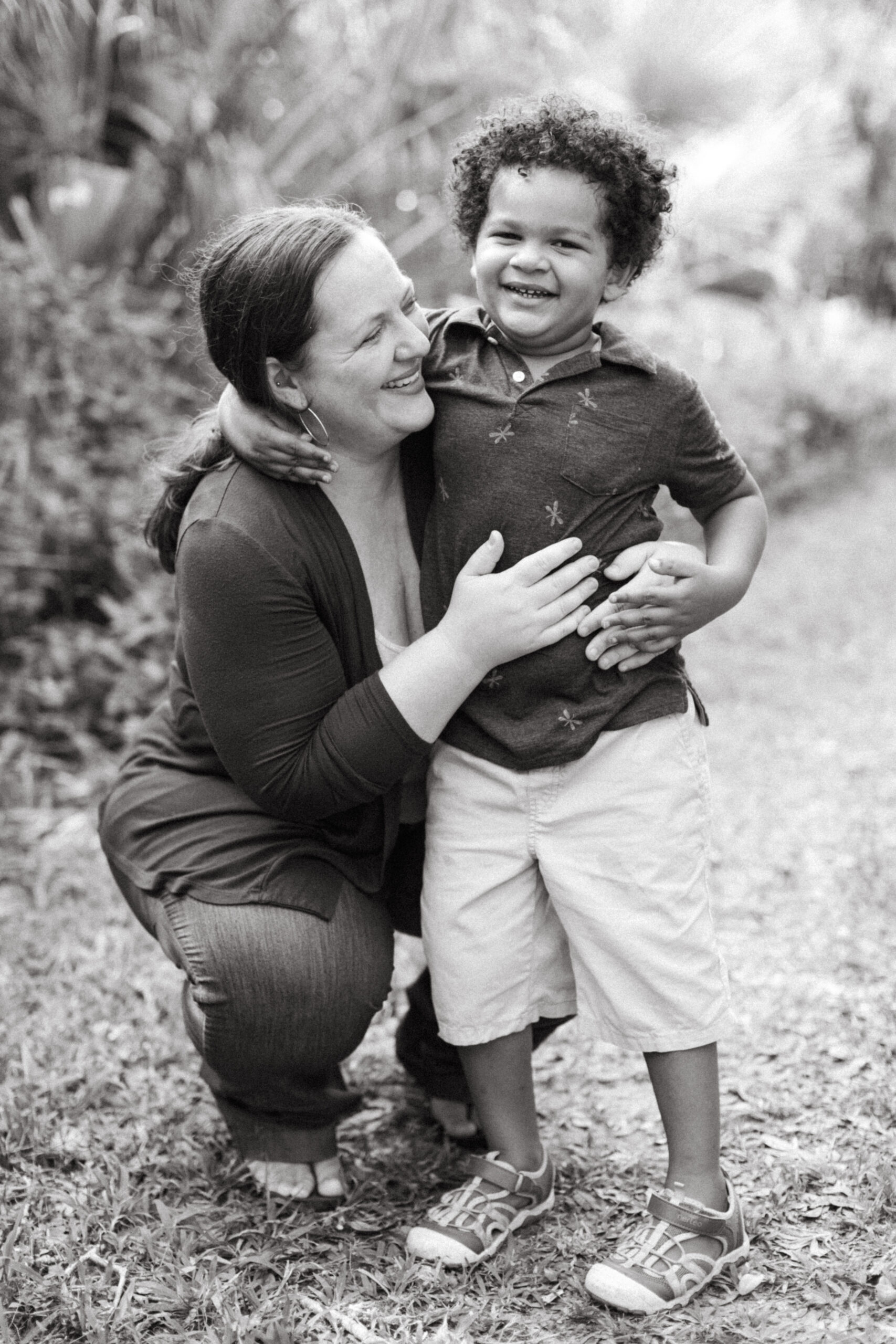 Mother holds her son in Venice, Florida