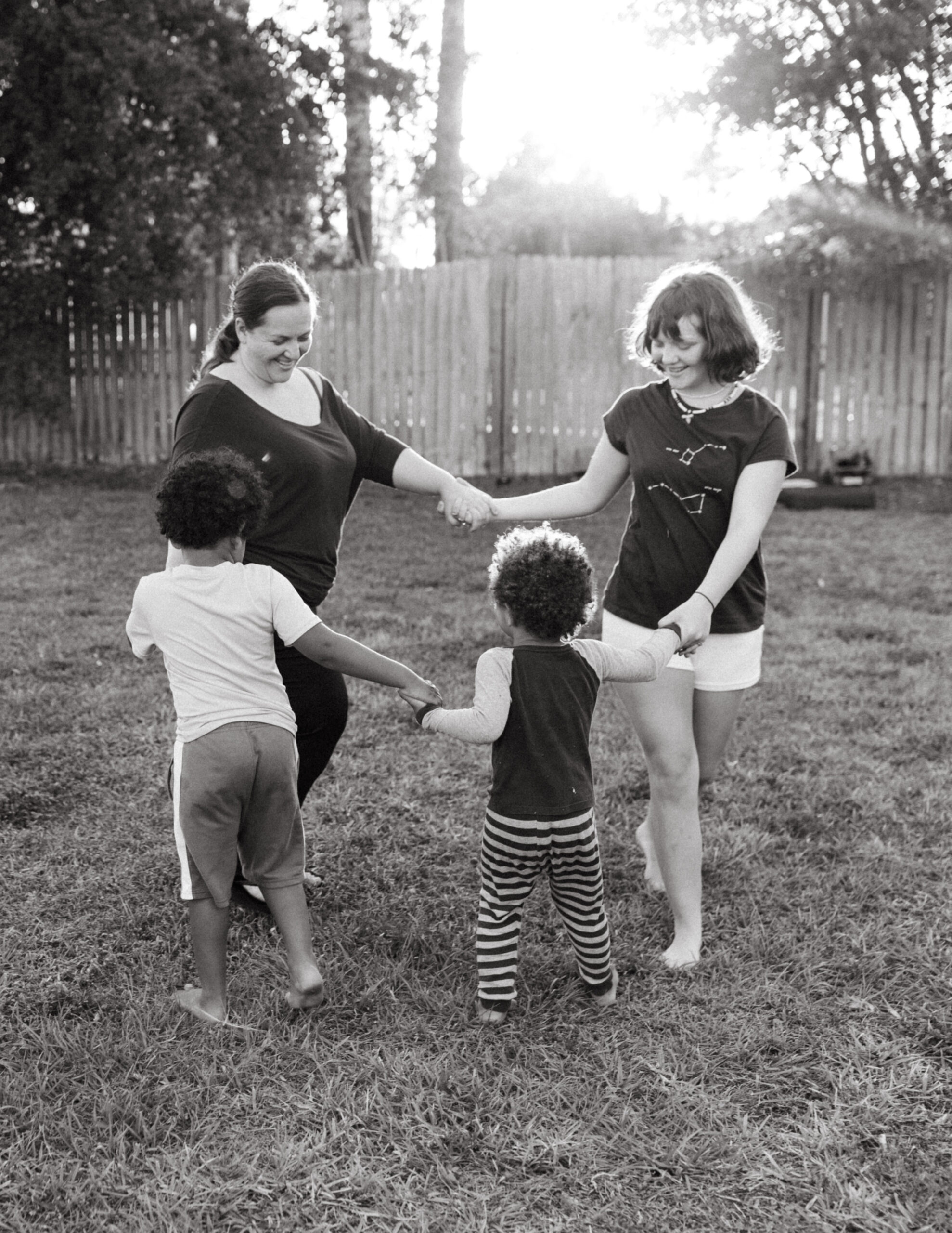 Mother plays with her children in the yard in Venice, Florida