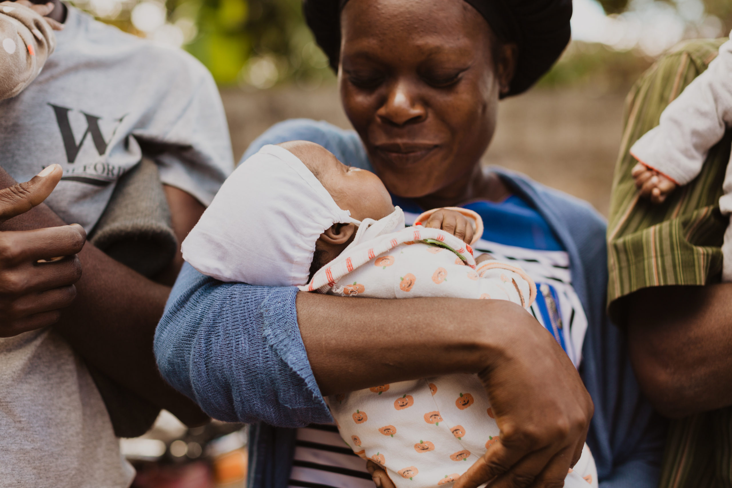 Humanitarian photographer photographs mother and child in Haiti